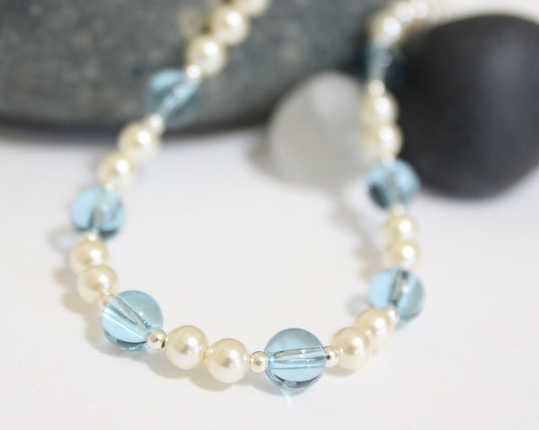 Pearl necklace with a pop of color