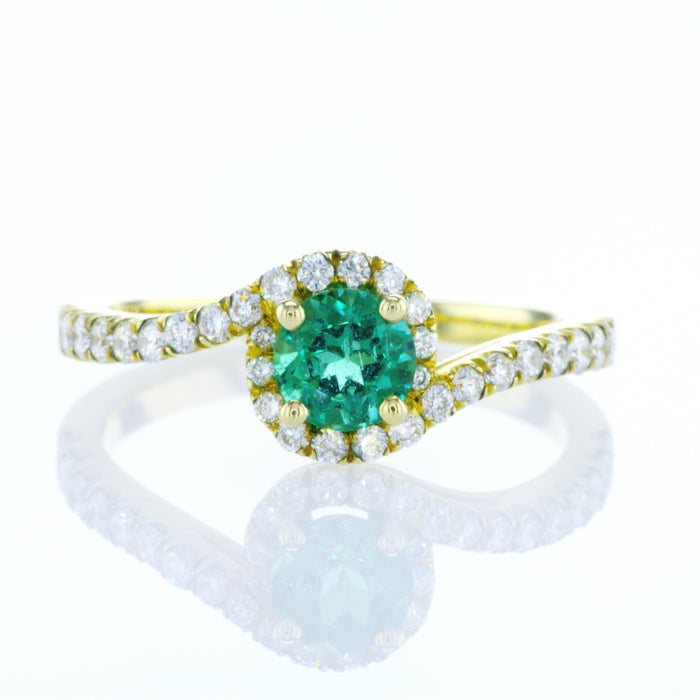"""Jennifer"" twist ring with a round natural emerald"
