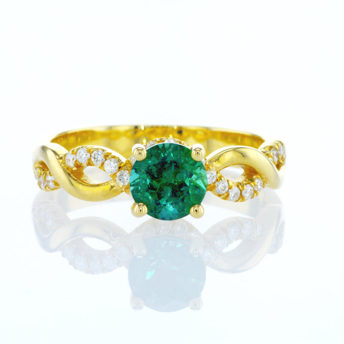 """Liv"" ring with a natural round emerald"