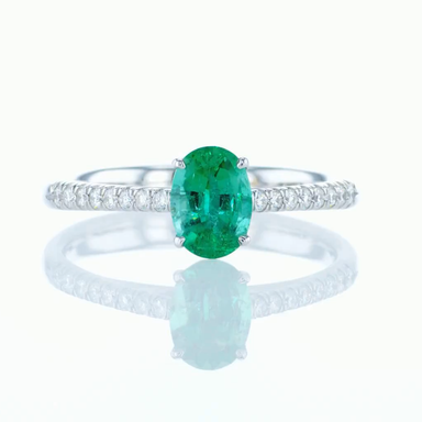 Engagement Ring With 0.82 ct Oval Shaped Natural Emerald & Diamonds