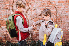 two little boys with backpacks