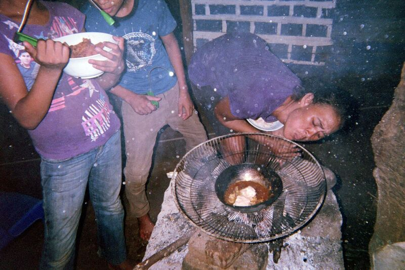 Nicaragua family cooking without electricity in Pantanal, poor neighborhood Latin America near Granada