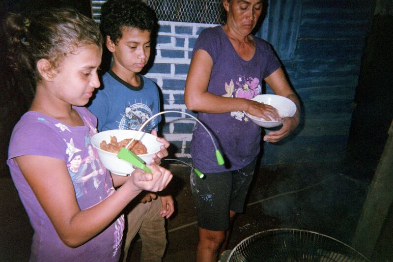 Nicaragua family cooking without electricity in poorest neighboorhood Latin America