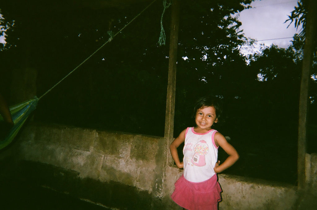 little girl in Nicaragua with red shorts