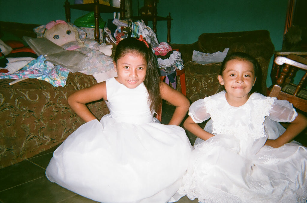 little girls in traditional white Nicaraguan dresses