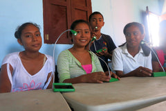 Students at Education Plus Nicaragua with solar powered lamp