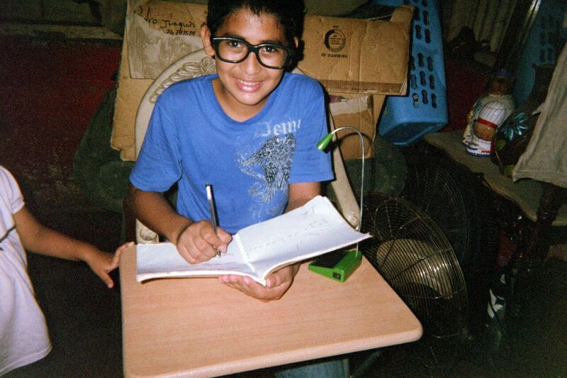 student of Education Plus Nicaragua studying with solar-light donated by Esperanza Market