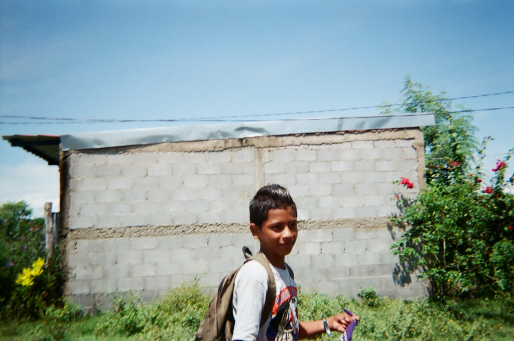 student walking to school on dirt road in Nicaragua