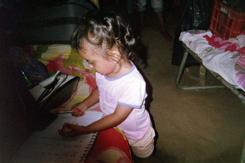 little girl in Pantanal Nicaragua stuyding without electricity in poorest neighboorhood Latin America