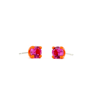 tangerine orange setting and deep pink lab sapphire earrings 5 mm three quarter view Funhouse Labs