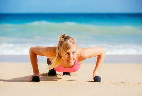 women doing pushup exercise