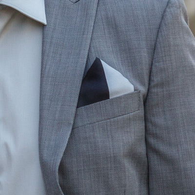 Lesovs Black and Gray Triangles Pocket Square Folded in Suit Pocket