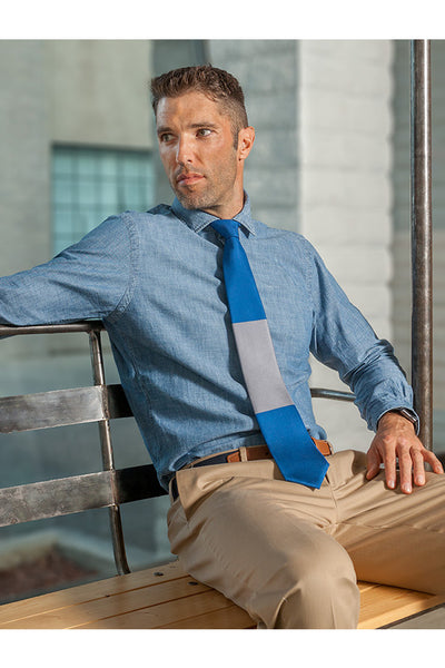 Lesovs Blue and Gray Block Tie Sitting Down