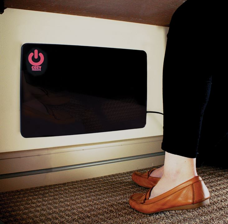 cozy legs flat panel heater mounted to a wall under a desk