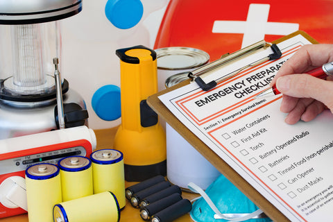 Flashlight, batteries, lantern, and first aid kit - emergency preparedness