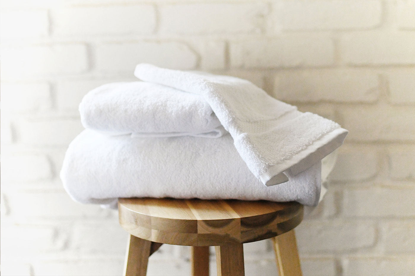 A stack of white luxury Supima cotton bath towels.