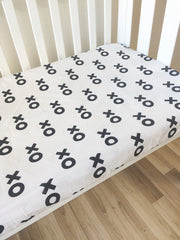 X O Hugs & Kisses in Black | Fitted Cot Sheet | Elske - Dream Child Emporium  - 1
