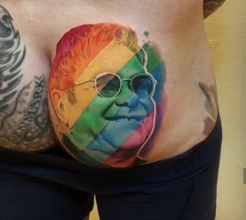 8cbf37fea This tattoo done by Lukov Nikov is our of this world. A pride themed piece  that's full of colour, and of course a smiling Elton John face. Amazing  work.