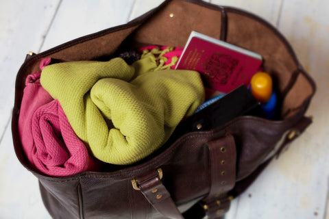 Sorbet hammam wraps packed into a travel bag