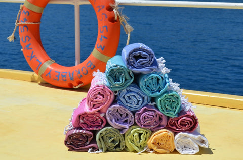 Colourful Sorbet holiday beach towels on deck