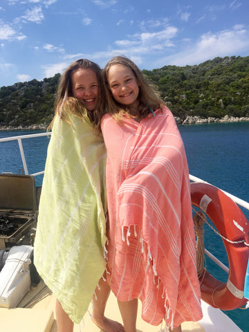 The girls wrapping up in Sorbet towels on deck