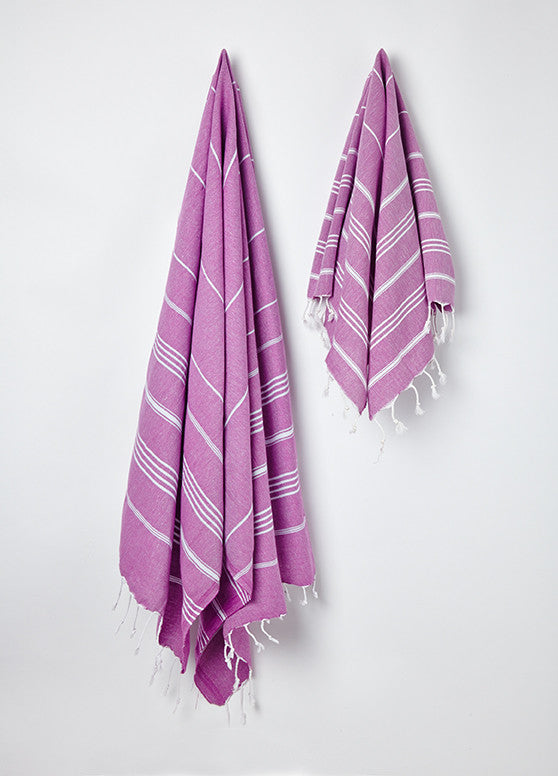 Hanging large and small Sorbet Hammam Towels in Blueberry purple