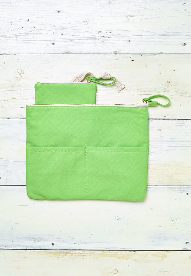 green beach clutch with detachable purse