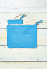 bright blue beach clutch bag with detachable coin purse