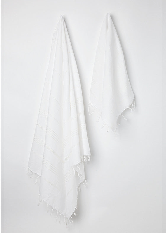 Large and small hanging Sorbet Hammam Towels in Coconut white