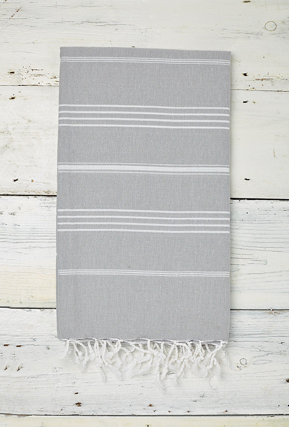 light grey hammam towel with fringe and hand tied tassels