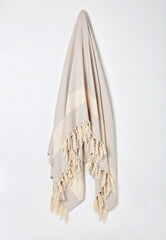 beige woven cotton throw