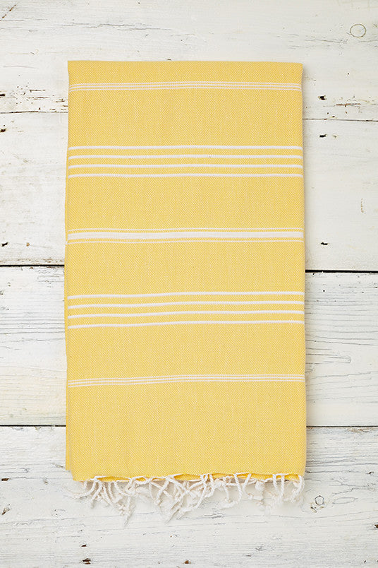bright yellow hammam towel with tassels
