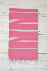bright pink hammam towel with tassels
