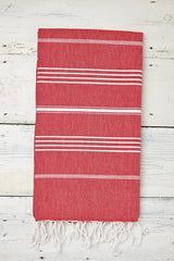 red and white hammam towel with tassels
