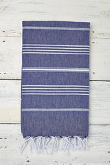 blue and white hammam towel with tassels