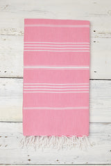 pink and white turkish hammam towel with tassels