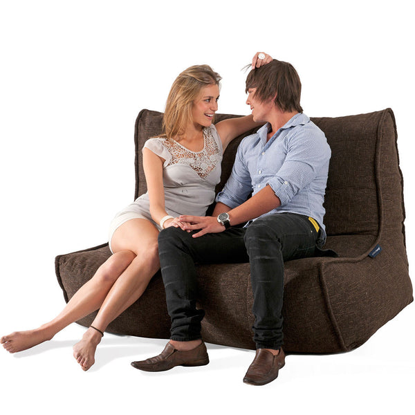 brown indoor couch by Ambient Lounge