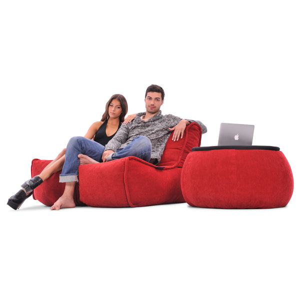 red indoor couch by Ambient Lounge
