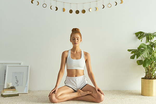 Half Lotus pose for Crystal Cove meditation pillow