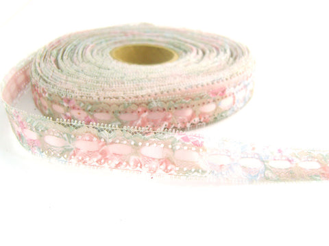 R4410 20mm Eyelet Lace over a Pale Pink Acetate Satin Ribbon