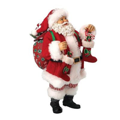 10 in. Santa Holding Miniature Stockings with Candy Canes