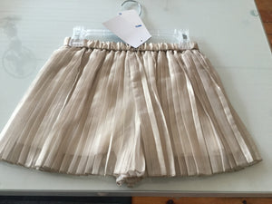 Pleated gold swing short