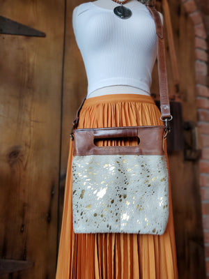 White and Gold Cowhide Handbag with Leather Handles and Leather Crossbody Strap