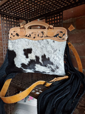 Black and White Cowhide Handbag with Black Fringe and Brown Leather Handles and Crossbody Strap