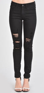KanCan black distressed skinny jeans front view.
