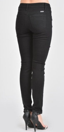 KanCan black distressed skinny jeans back view.
