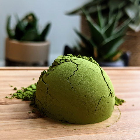 pile of green matcha on bamboo tray