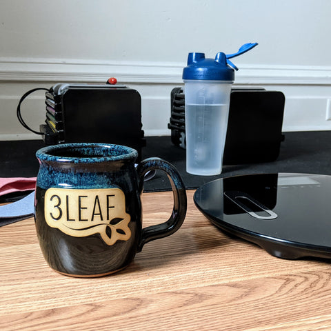 3 Leaf Tea mug with workout equipment in background