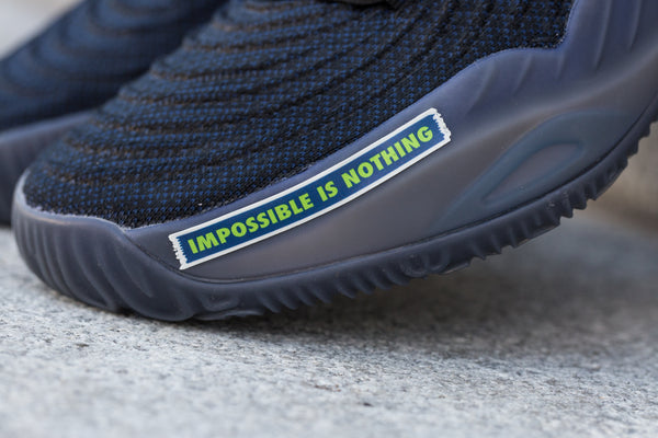 IMPOSSIBLE IS NOTHING - NAVY/ELECTRIC GREEN