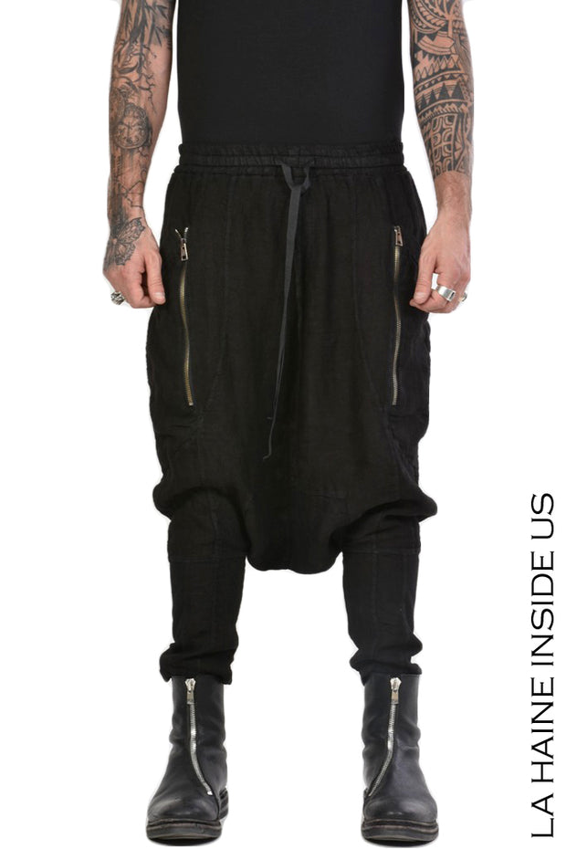 Traffic drop crotch linen trousers